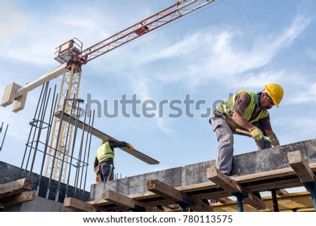 Worker At The Construction Site Is Fixing Forms For The Beams. #780113575