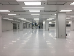 Worker building in clean room at factory.