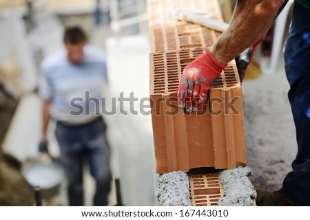 Worker Building On Wet Layer Concrete, Brick Wall