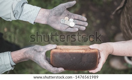 Worker buys bread for last money #1476561989
