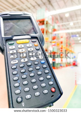 Worker Checking and Scanning Package by tablet handheld In Warehouse. #1500323033