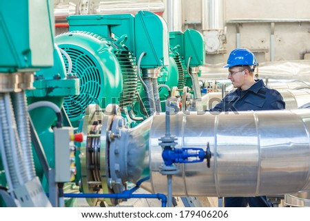 Worker controls quality of work in the factory hall