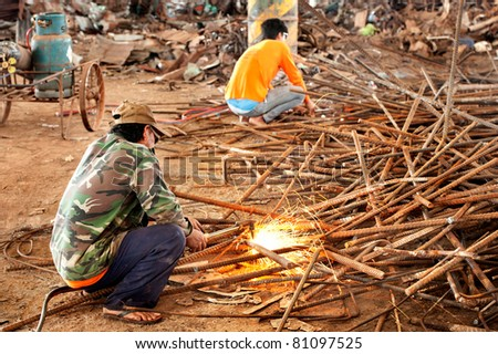 worker cutting iron by  torch cutter
