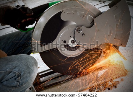 worker cutting steel