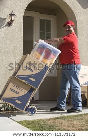 Worker delivering cardboard boxes