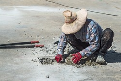 worker drilling cement.