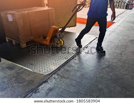 Worker driving forklift loading shipment carton boxes goods on wooden pallet at loading dock from container truck to warehouse cargo storage in freight logistics, transportation industrial, delivery Сток-фото ©