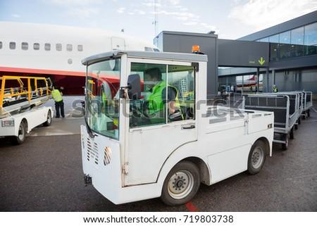Worker Driving Vehicle On Runway