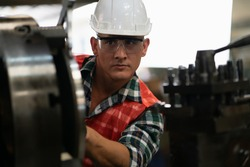 Worker factory man inspector concept. Inspection technician, factory engineer, inspection of the machine condition in the factory. Inspection by technicians, industrial business, production machinery
