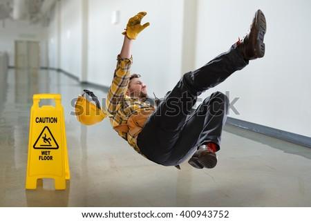 Worker falling on wet floor inside building Stock photo ©
