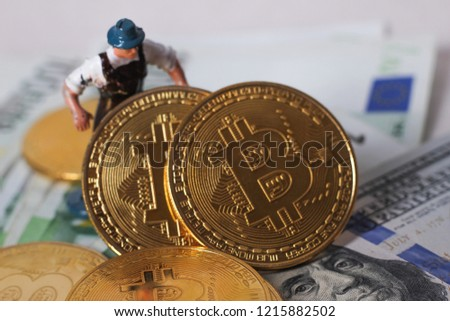 worker figur hold bitcoin #1215882502