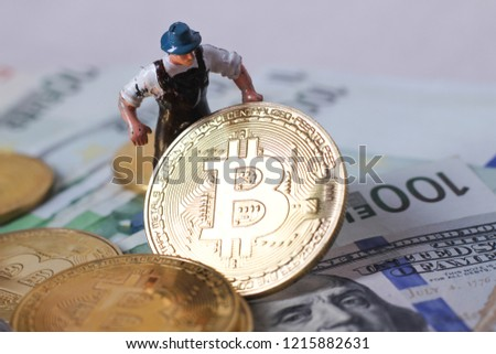 worker figur hold bitcoin on dollar #1215882631