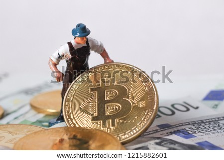 worker figur hold bitcoin with dollar background #1215882601