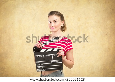 worker film industry/ young girl with a clapperboard cinema #233021629