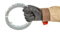 Worker hand in black protective glove and brown uniform holds coil of perforated metal mounting tape isolated on white background