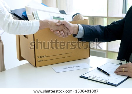 Worker handshake to boss say good bye in the case for resignation process. Staff want to quit from the job in the company. Сток-фото ©