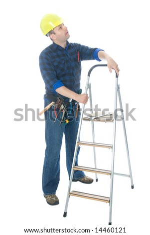 Worker (handyman) standing near his ladder and looking up