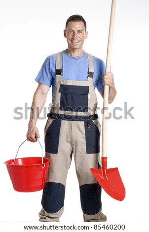 Worker holding a red bucket and shovel on white background.