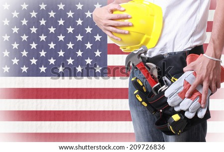 Worker holding tool for working on labor day