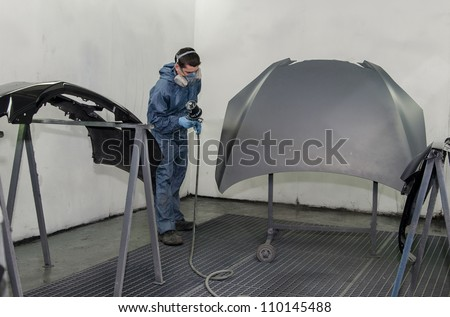 Worker in a paint booth.