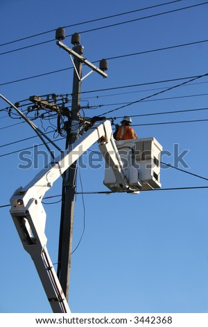 Worker in cherry picker