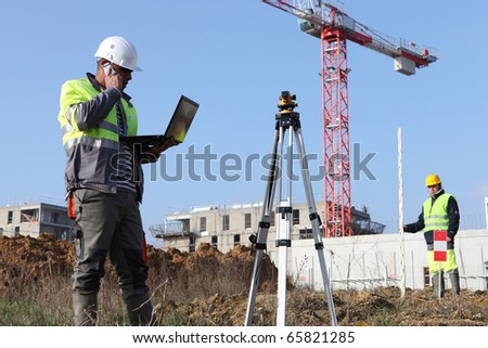 Worker in front of a laptop computer on site
