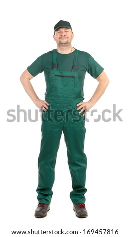 Worker in green overalls. Isolated on a white background.