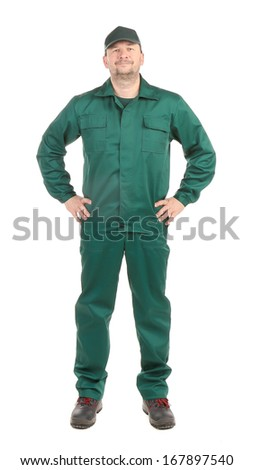 Worker in green workwear. Isolated on a white background. - stock photo
