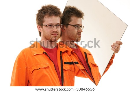 worker in orange workwear carries a mirror, isolated on white