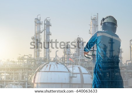 Worker in petrochemical plant concept, Double exposure technician in oil and gas refinery industry with sunset sky #640063633