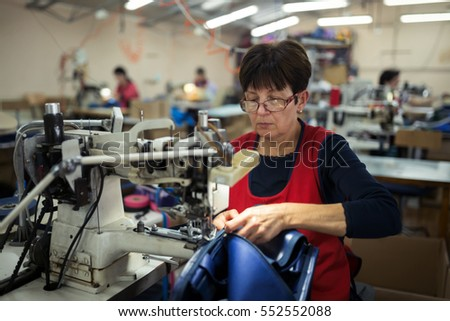 Shutterstock Worker in textile industry sewing on machine