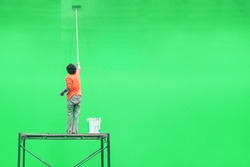 worker is painting green color for green screen studio