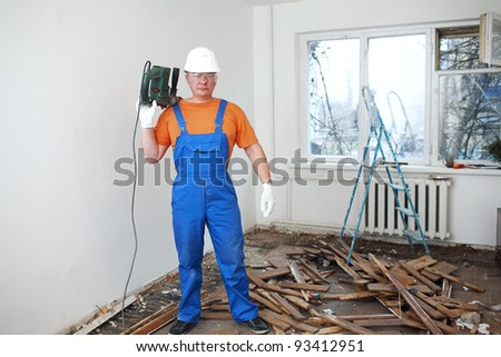 worker makes repairs in the apartment