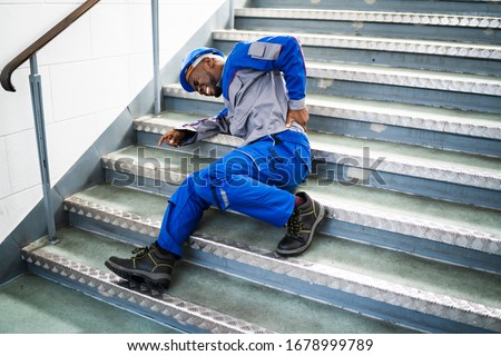 Worker Man Lying On Staircase After Slip And Fall Accident Stock photo ©