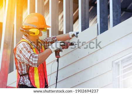 Worker man with safety helmet Construction building industry, new home, construction interior service concepts - Selective focus. vintage film grain filter effect styles