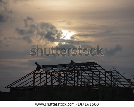 worker men building home on roof with sunset on evening #147161588