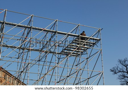 worker on a scaffold in turin Italy