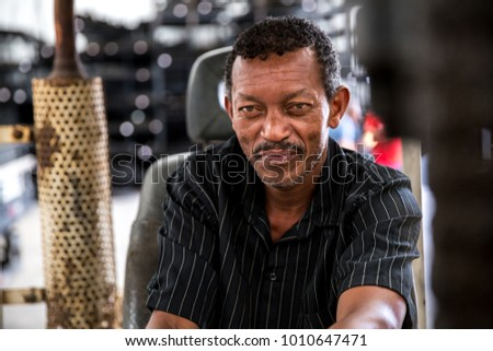 Worker on Forklift Looking at Camera Foto stock ©