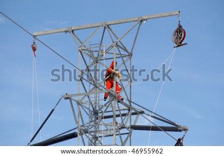Worker on top of hydro tower