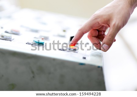 Worker operating a machine in a factory