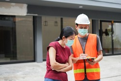 Worker or inspector is checking house inspect and audit problem point out advice with checklist and pointing new building with customer or client Inspection and engineering concept