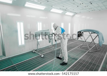 Worker painting a car parts in a paint booth, #542175157