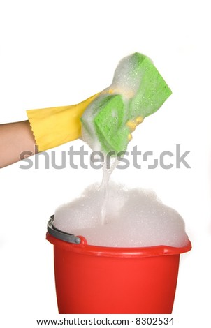 Worker protecting hand from detergents as they use a cleaning sponge.