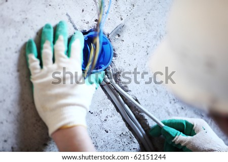 worker puts the wires - stock photo