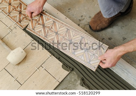 Free Photos Laying Ceramic Tiles Worker Putting Tiles On The