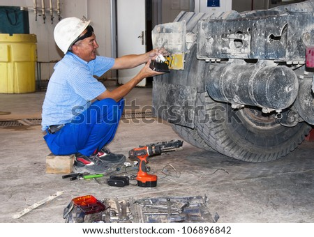 worker repair the truck