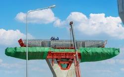 Worker rest on Highway overpass bridge structure, pillar concrete, work platform, scaffolding, reinforced and rebar steel on the under construction road.
