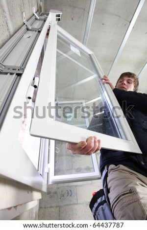 Worker setting up a window - stock photo