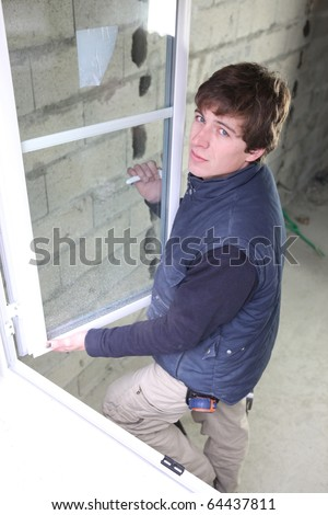 Worker setting up a window