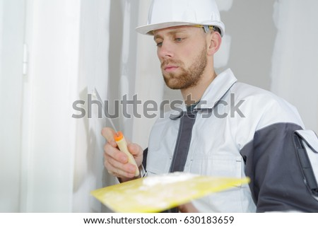 worker spreading plaster to wal #630183659